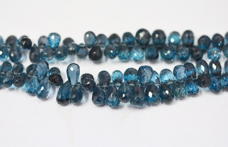 Natural London Blue topaz tear drop briolette  5x7-7x9 mm  4\u201d strand  Blue topaz drops