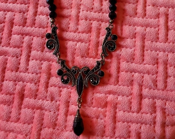 NECKLACE: Bib/choker style. Black Swarovski crystal beads