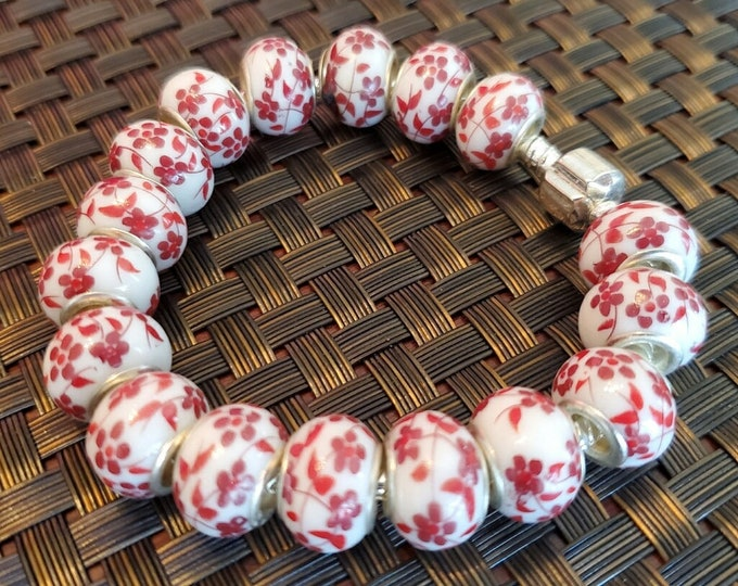 Red and white ceramic Lampwork beaded bracelet on a silver snake chain