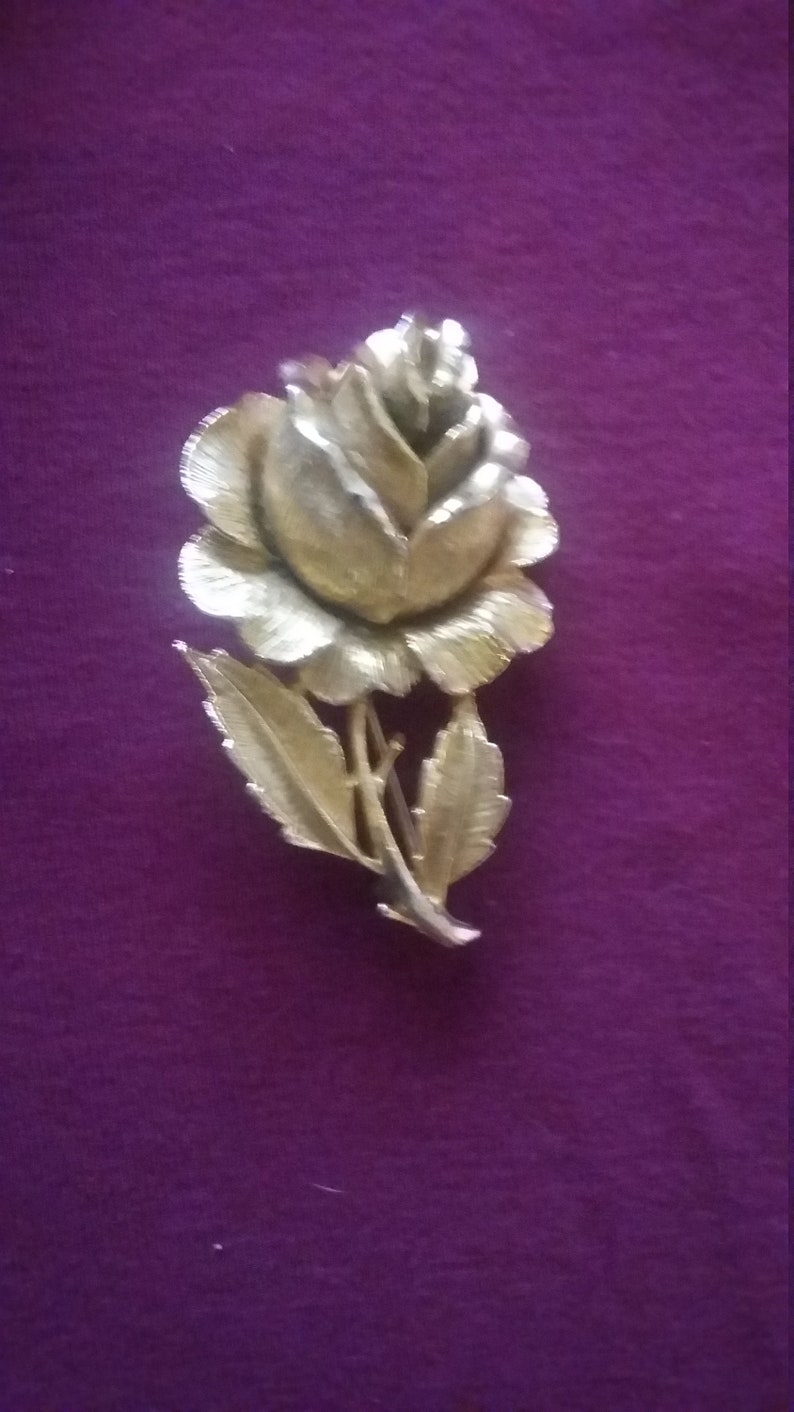 Gold rose flower brooch