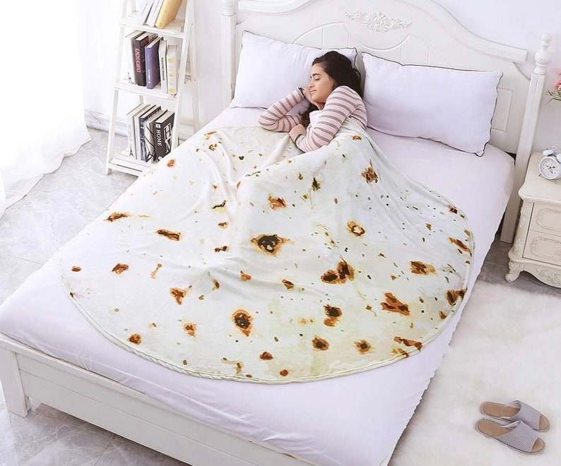 A truly awesome blanket for anyone Wrap up yourself or a loved in a flour tortilla and add guacamole Softest Burrito Blanket Ever