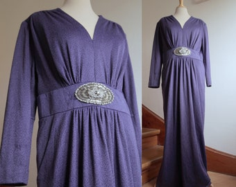 Purple Blue Elegant 1970s Evening Gown with a Deep V Neckline, Long Sleeves, Large Beaded Application and Pockets | Käthe Wettley Modell