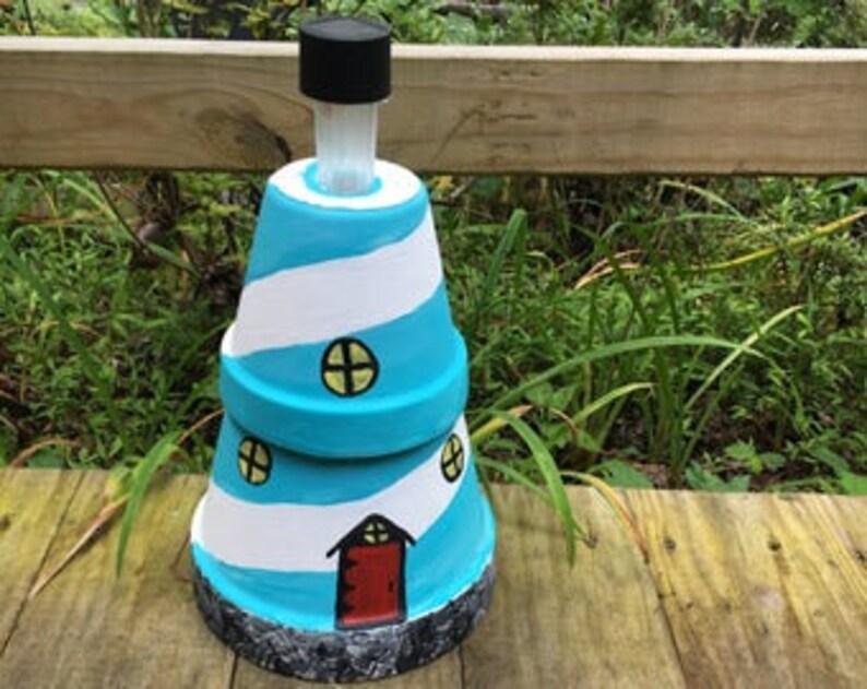 Solar clay pot lighthouse on clay pot lighthouse, diy flower pot lighthouse, plant container lighthouse, cat pot lighthouse,