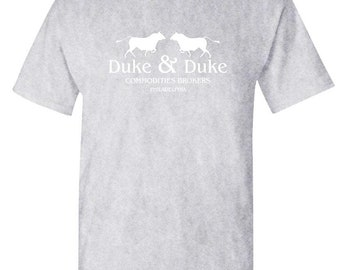 edb4e49a DUKE AND DUKE Commodities Brokers - Unisex Cotton T-Shirt Tee Shirt
