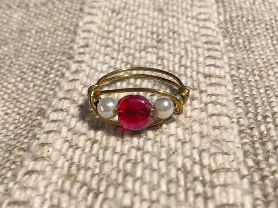 white bead wire ring
