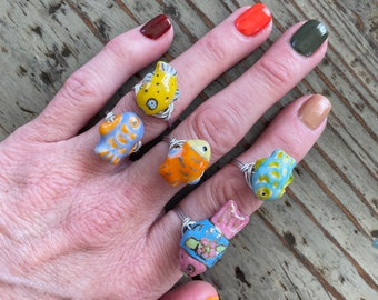 Porcelain Ceramic Wire Wrap Fish Rings. Cute and Colorful available in different sizes, fishies