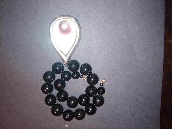 1 statement necklace
