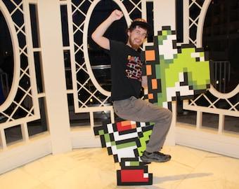 Yoshi pixel cosplay ride from Super Mario World