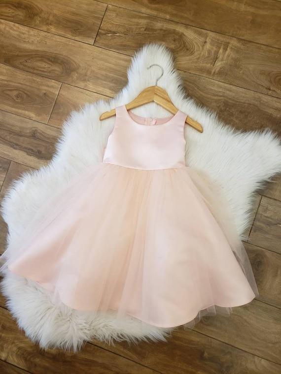 Blush satin and tulle flower girl dress. Classic yet elegant.