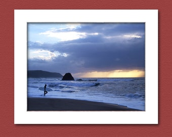 Photo print, picture of a surfer at sunset, Widemouth Bay, Bude, Cornwall, UK. 12 x 8 inch print to fit standard size frame.