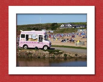 Pink ice cream van at the beach, Bude, Cornwall, UK.