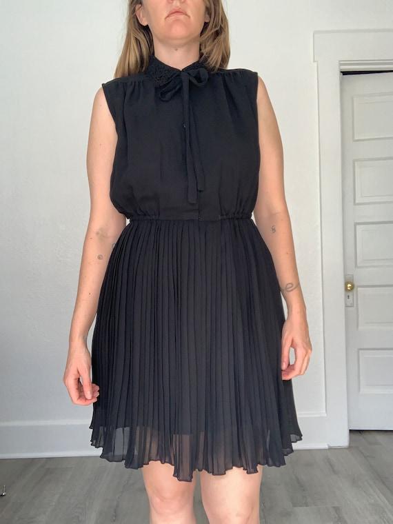 80's flirty little black dress
