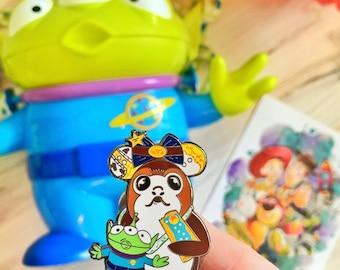 Porg with Woody Magic Mouse Ears & Toy Story Alien popcorn bucket and Pixar Pop tart. Hard Enamel Pin