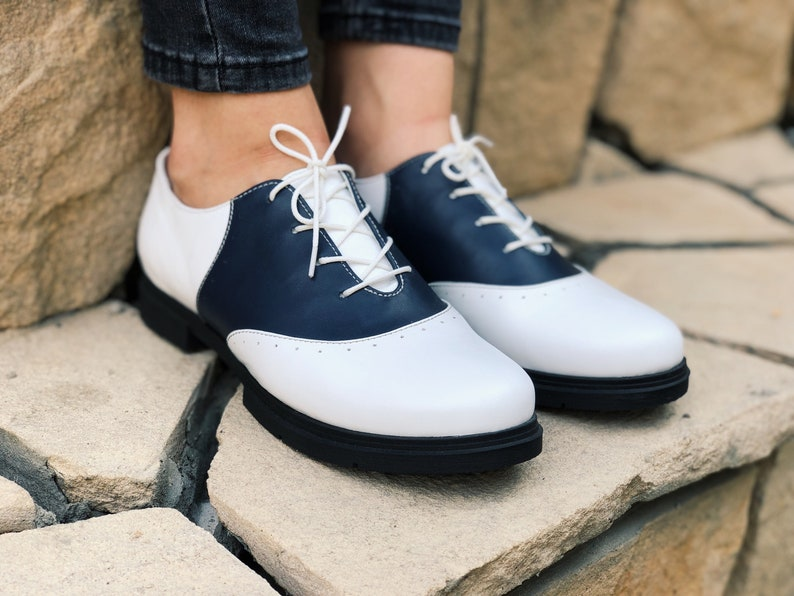 1950s Style Clothing & Fashion Oxford Shoes For Woman In White Leather Saddle Oxfords Deep Blue Wide Width Two Tone Hipster Oxfords Low Heel $140.00 AT vintagedancer.com