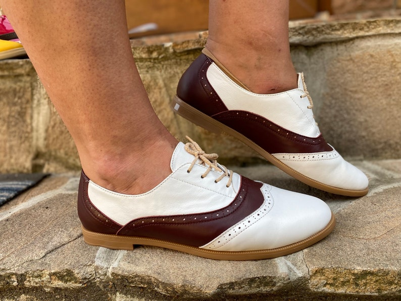 Saddle Shoes History- Women's and Men's Womens Oxford Shoes White Leather Brown Oxford Flats Classic Style Large Size shoes For Woman Custom Wide Width Oxfords $140.00 AT vintagedancer.com
