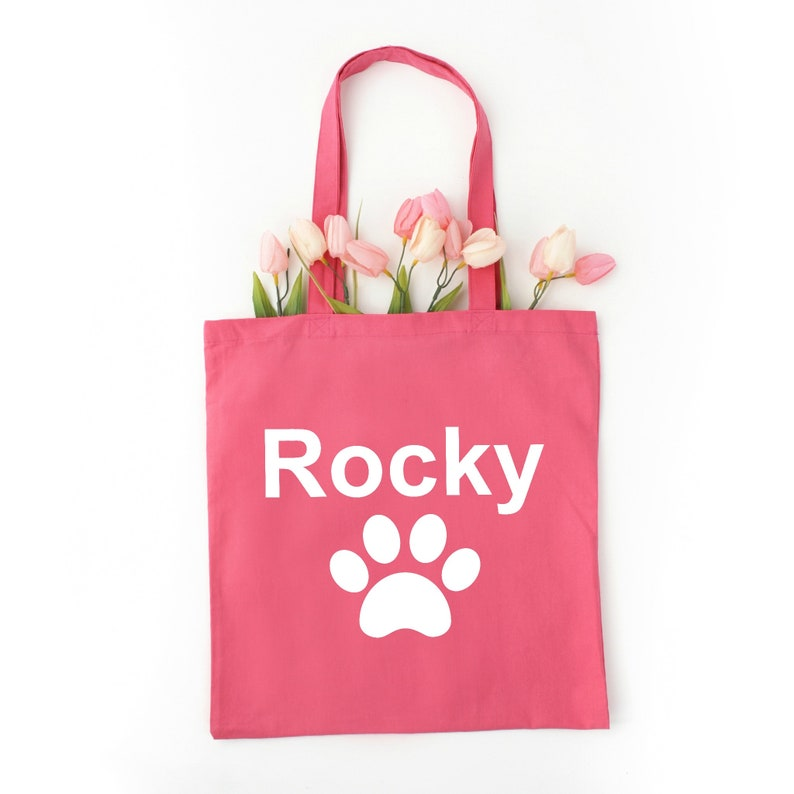 Let the world know you are an animal lover with the name of your special pet on a tote with paw designs use as a grocery tote or book bag