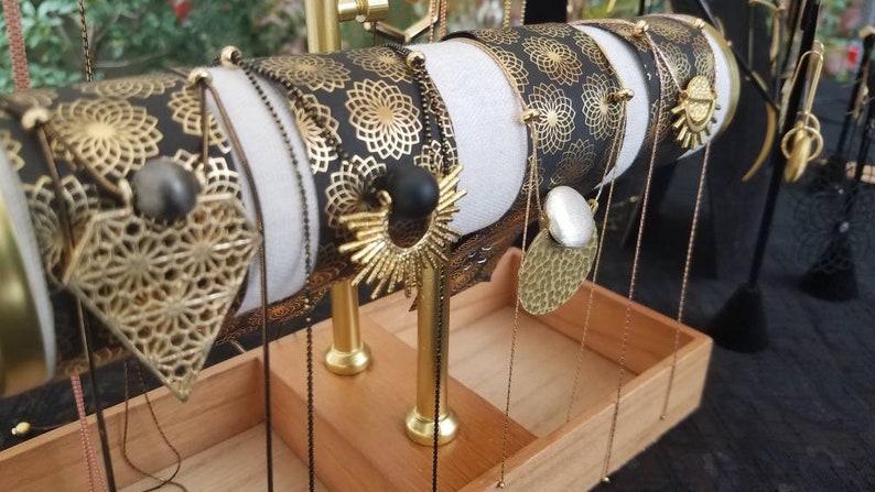 Solar Eclipse original plaything studio design matte onyx ball framed in gold sun