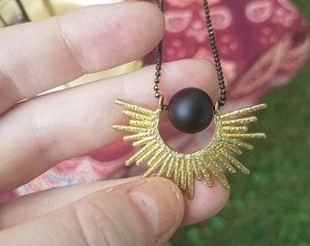 Solar Eclipse - matte onyx ball framed in gold sun - original plaything studio design