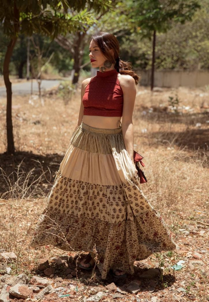 Hand block print ajrakh multi tiered skirt and crop top set made using natural dyes