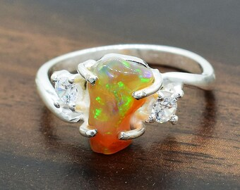 The Opal is a natural stone and is the birthstone for Oct Oval Opal ring in solid sterling silver with fancy bezel and a twisted wire band