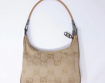 3b5d79a92 Vintage Gucci monogram bag