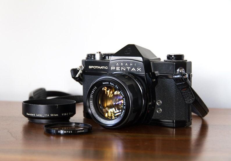 Asahi Pentax Spotmatic SP: Vintage 35mm SLR with working meter, fast  Super-Takumar 50mm f1 4, lens hood, leather Pentax strap, and UV filter