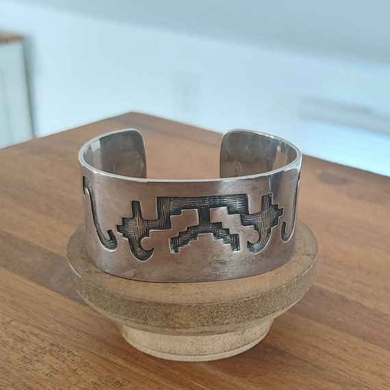 Hollow Geometric Silver Bracelet with Turquoise Accents is made in Mexico