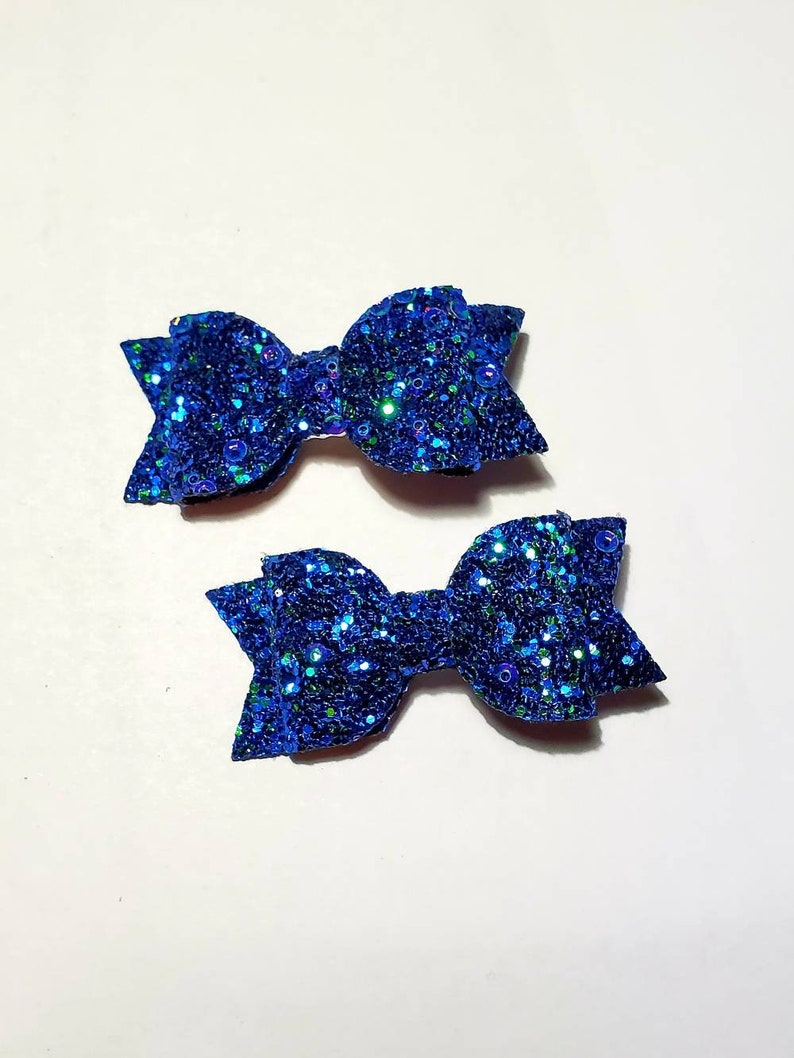 Red royal Glitter fabric The perfect Christmas pigtails. ombre and black A pair of 2 inch sequin hairbow with clip