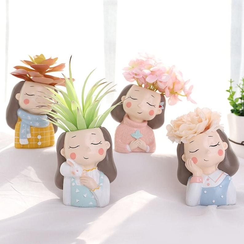 grappige bloempotten met een gezicht erop