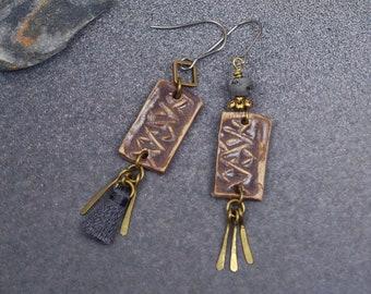Asymmetric tassel earrings