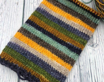 in Holiday Lights on a Rainy Night Superwash Merino and Nylon 7525 Fingering Weight Self Striping Sock Yarn