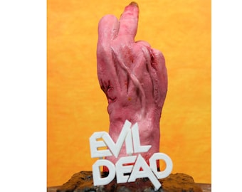 Evil Dead severed hand collectible. Ash's possessed evil hand with attitude, giving the finger. Great for any horror fan or haunted house