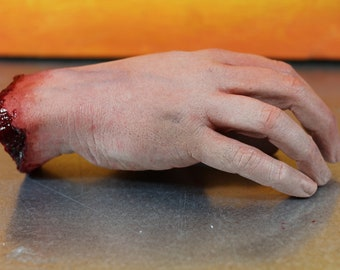 Bloody severed silicone hand, realistic.  Great for Halloween decoration, haunted house or horror prop
