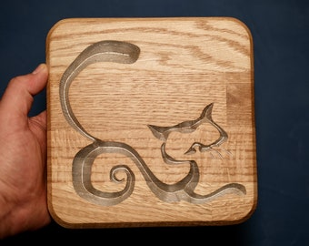 Abstract cat wall display carved from oak