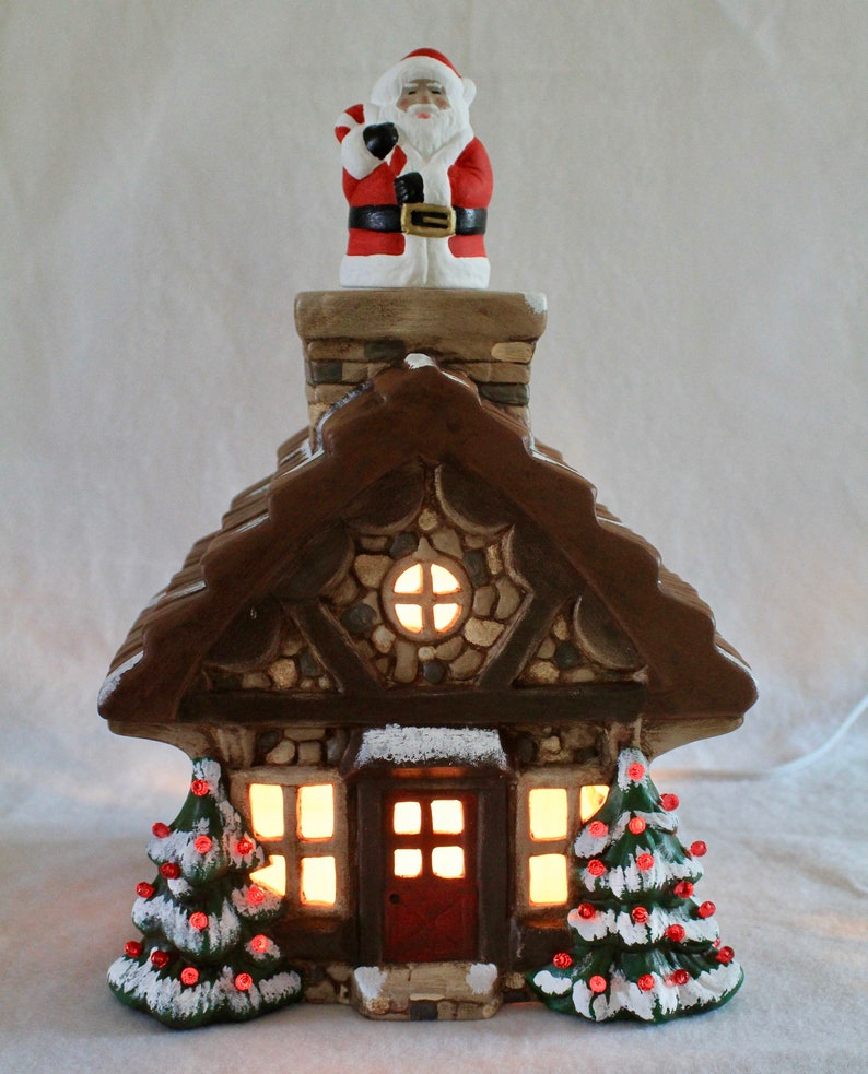 Realistic ceramic cabin-style house with decorated trees