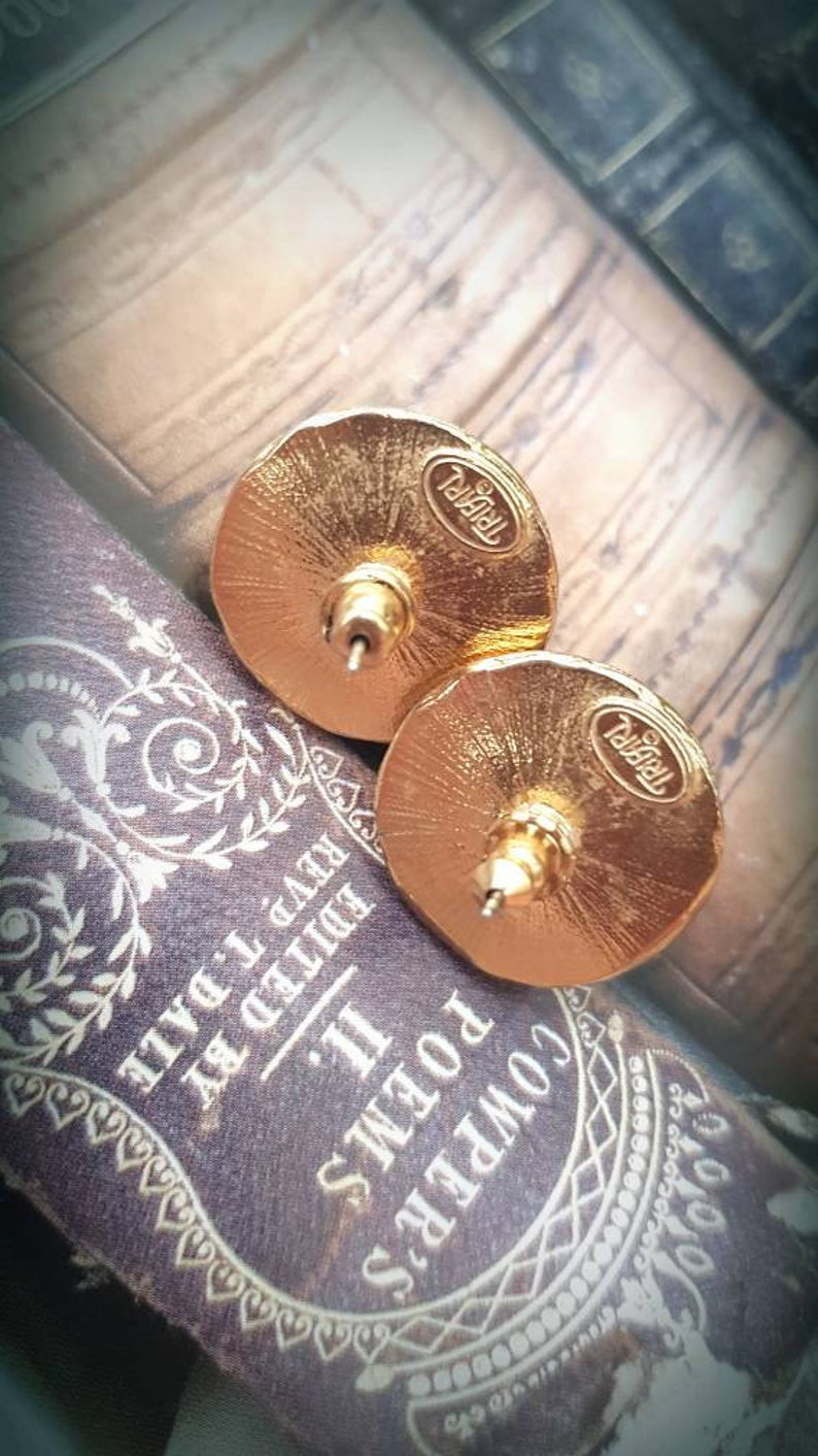 signed /'Trifari/' timeless elegance gold and black large stud earings swirl gold tone design Trifari earings