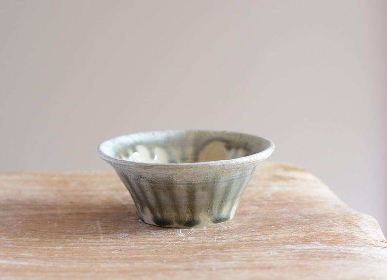 stoneware salt pot. Small handmade bowl with drippy grey glaze