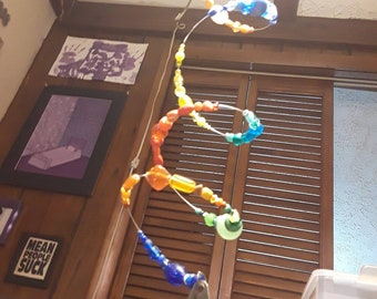 Spiral wind spinner. FREE SHIPPING USA Multi-color beads with a bell or air freshener locket Hang on a tree porch or in your home or garden.