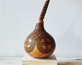 Hand-carved gourd. Natural, organic decor. Beautiful cross detail.