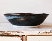 Handmade ceramic serving bowl. Black and blue pottery dish. Vintage Sherry Wells pottery, Montanna potter.