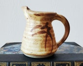 Small pottery pitcher. Tan and brown creamer. Handmade clay pitcher.