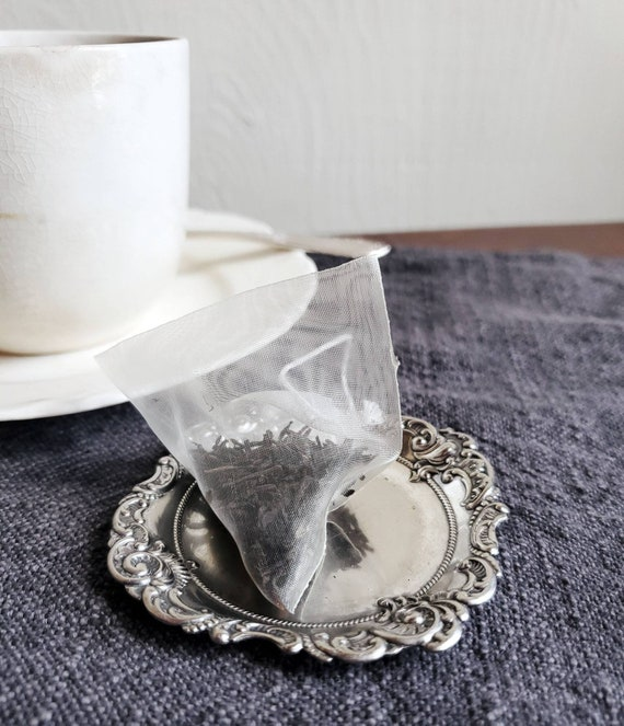 Silver plate butter pats. Great for ring dish, tea bag holder, spoon rest.