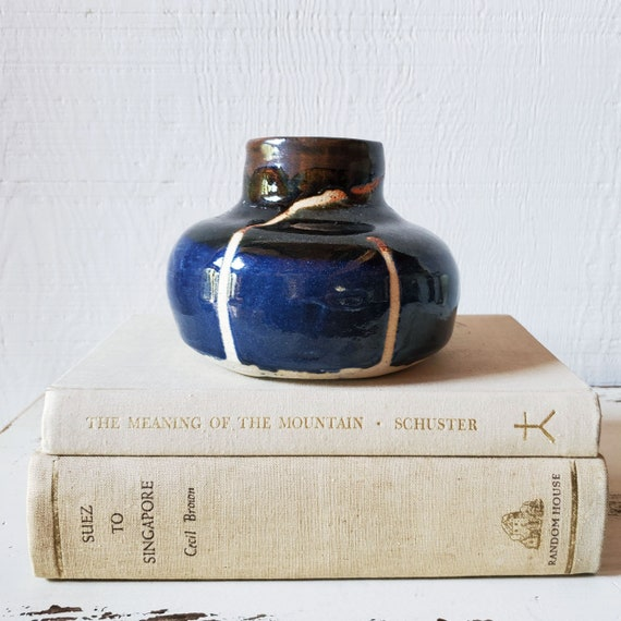 Sweet handmade pottery vase in indigo, brown and white.