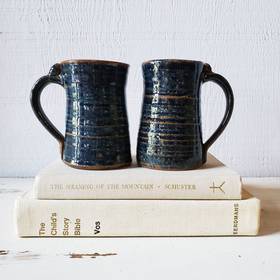 Pair of gorgeous navy blue and brown pottery mugs. Hand made, vintage mugs.