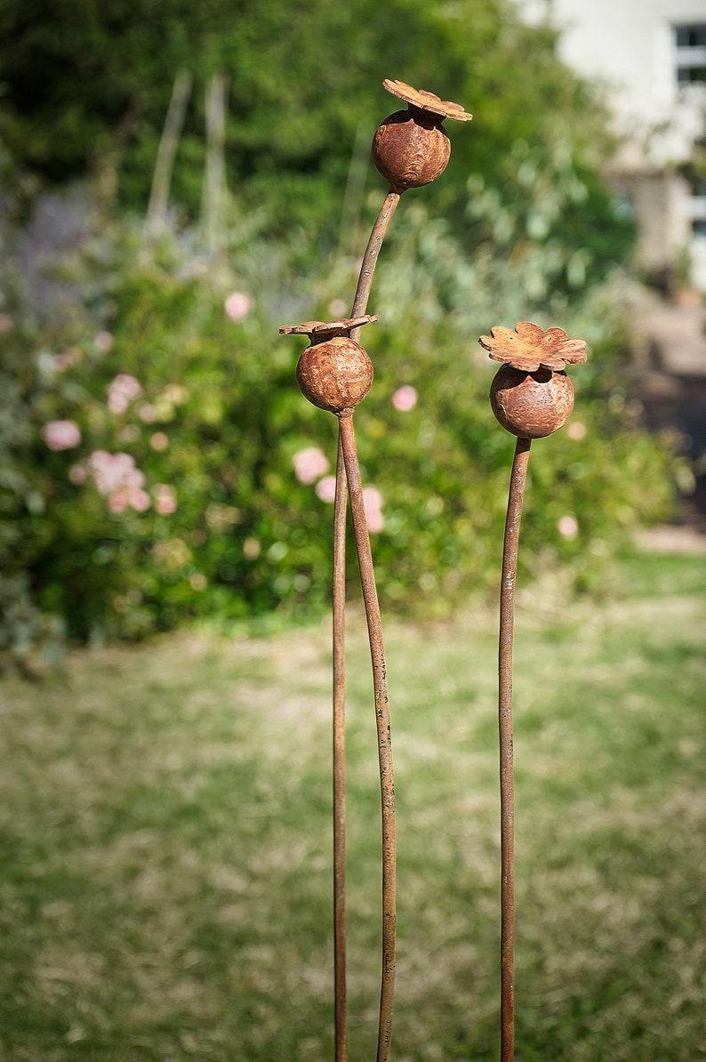 Rusty metal Poppy seed head garden sculptures / garden art ...