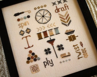 A Spinner's Sampler cross stitch chart by October House