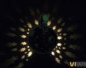 Moon and stars night light projector. Luminous shadow lamp cosmonaut on the Moon