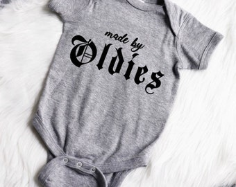 Made by Oldies Infant baby bodysuit/toddler tee (Grey/Black) oldies but goodies ,funk, spanish sayings baby shower gift sibling shirts