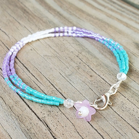 Purple pink seed bead friendship bracelet. Dainty four strand friendship bracelet
