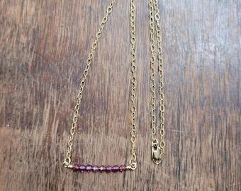 Purple garnet and gold bar necklace